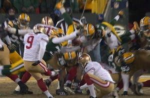 The reason he got so close to blocking the kick is that he was offsides. Broadcast team Joe Buck and Troy Aikman failed to notice this, because they are morons