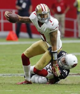 Kaep gets dragged down at the end of his ridiculous 2-yard scramble